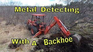 Metal Detecting With A Backhoe