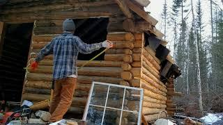 Installing the front window: OFF GRID LOG CABIN BUILD